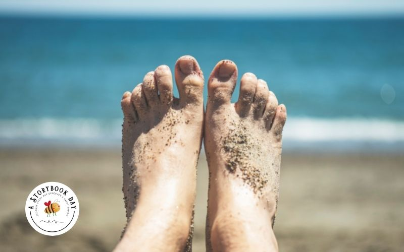 Feet on the Beach covered in sand