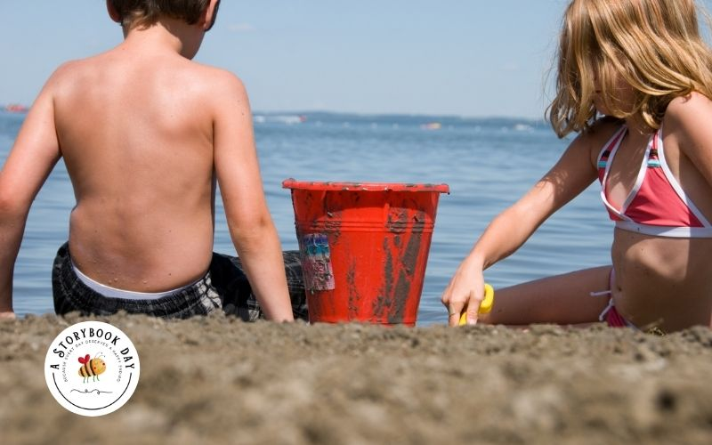 kids playing on the beach with a sand bucket