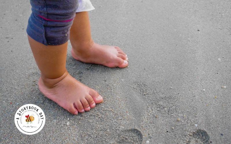 toddler feet on the beach